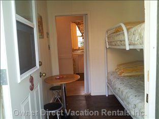 Cheerful,  Kid Friendly Separate Room with Bunks Beds. Door Opens to Courtyard and is Separate from Main Bedroom