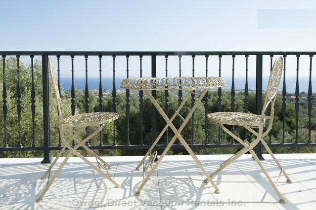French Provical Style Chairs on the Balcony Overlooking a 360 Degree View of the Ionian and Mountains.