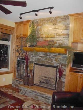 Fireplace in Living Room, Wine Fridge Left, TV to the Right.