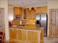 Kitchen with Stainless Steel Appliances and Granite.