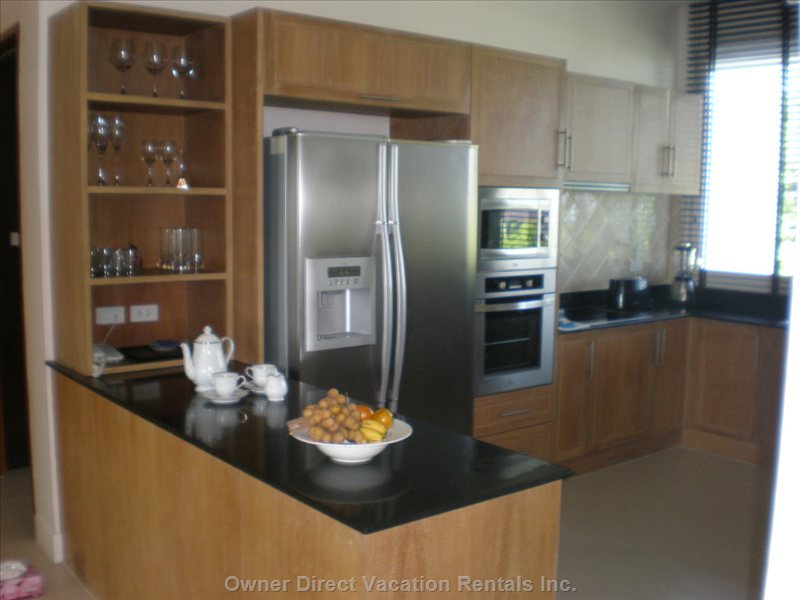 The Open Plan Kitchen is Fully Equipped. -  Separate Laundry Room.