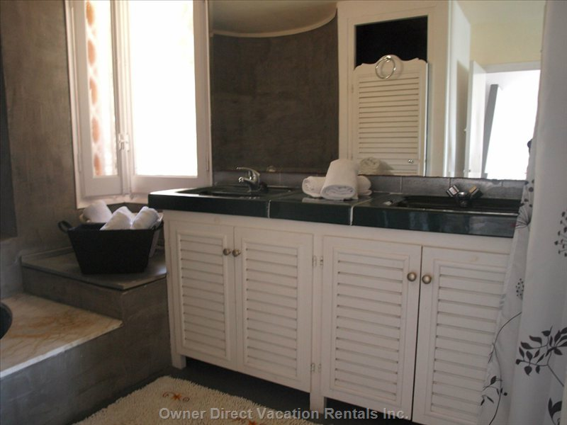 Double Sink in Master Bedroom, with Big Round Bath and Independent Shower