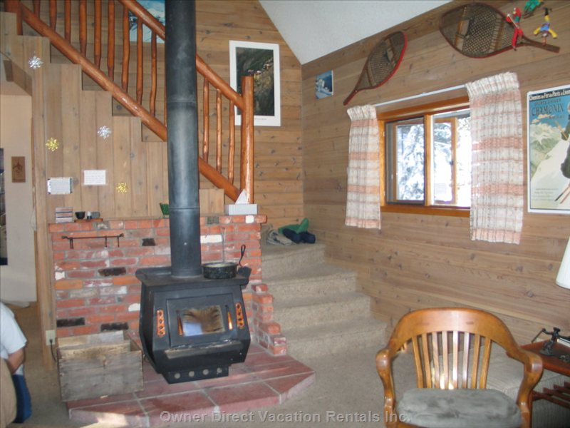 Wood Stove and Open Staircase to 2 Upper Bedrooms