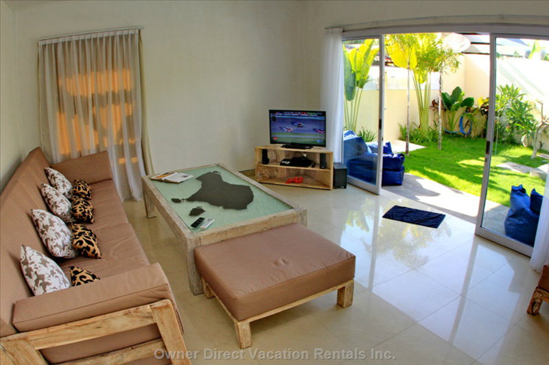 Spacious Living Area with Direct Access to the Garden
