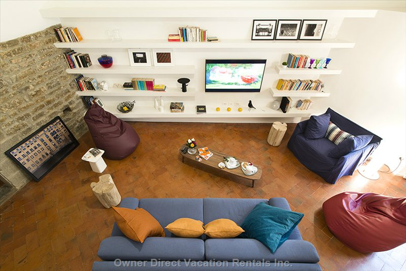 "View of Living Room from Top of Staircase. The Sofa Bed has Two Single Beds 55"" Tv, Unlimited Wifi"
