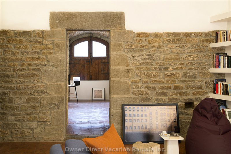 The Thick Wall of the Medieval Tower. View of the Entrance from the Living Room
