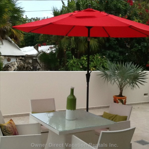 Large Private Patio for Outside Dining and Loungers.