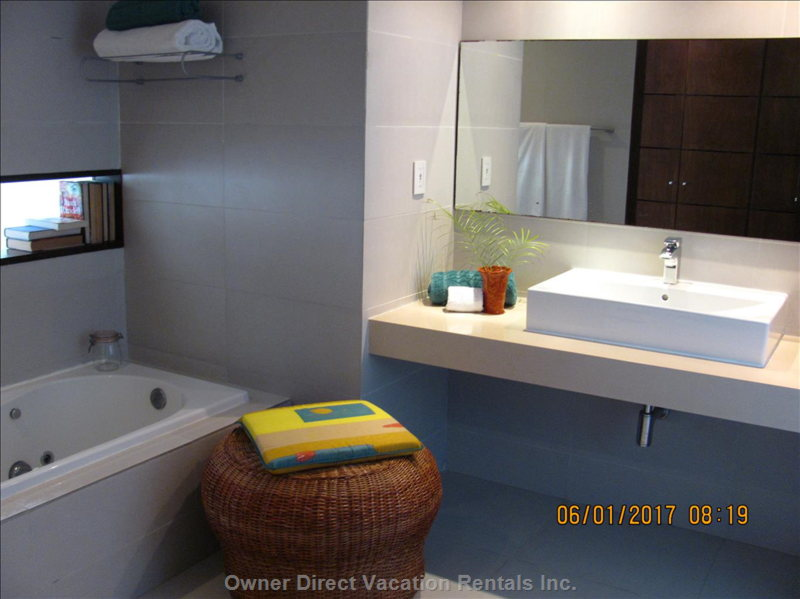 Ensuite for Main Bedroom with Tub and Separate Shower.