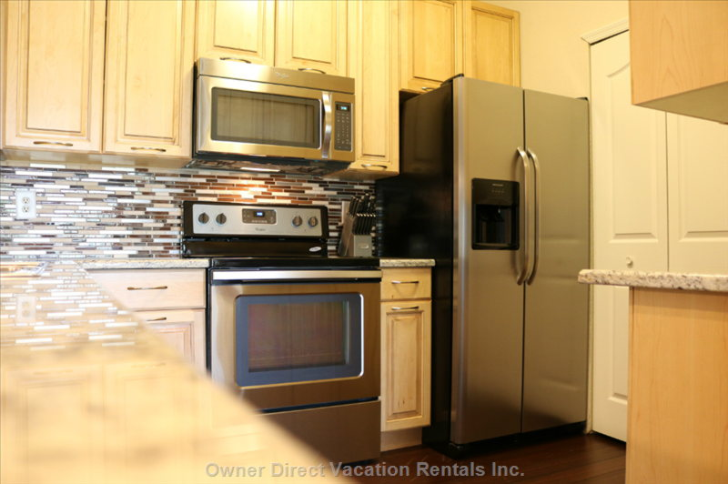 Remodeled Kitchen with Solid Maple Wood Cabinets and New Applicances