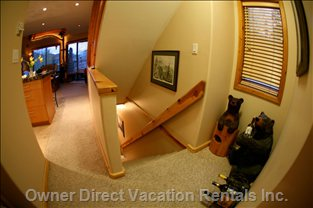 Stairs from Ground Level Entrance to Condo. Ski Racks and Boot Heater at Bottom of Stairs.