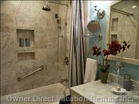 Master Bathroom  - Dual Shower Head, Lots of Counter Space, Storage for your Personal Travel Items.