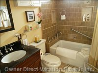 2nd Bathroom - the Full Size Bathroom has a Wall Mounted TV and Phone.