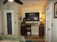 Master King Suite has 50 Inch TV - Ceiling Fan, Walk-in Closet, Surround Sound.