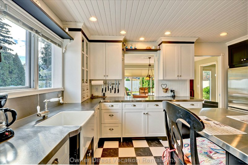 Bright Kitchen with Wood Cabinets and Stainless Steel Counters