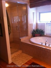 Master Bedroom Ensuite with Large Shower and Soaker Tub.