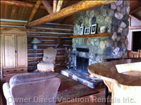 Great Room with Natural Stone Log Fireplace. Open Concept with Granite Kitchen Bar. Big Windows and Views of Surrounding Mountains.