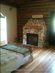 Master Bedroom on Main Floor. Natural Stone Gas Fireplace. Hardwood Floors and Ensuite.