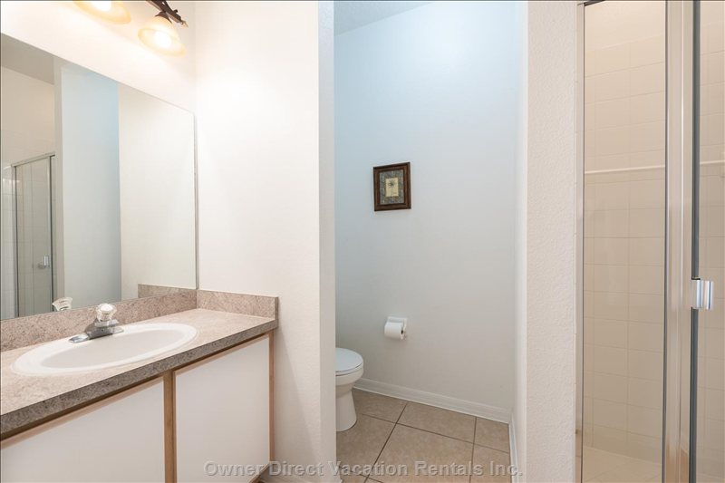 2nd En-Suite Bathroom Includes a Shower, Sink Vanity with a Large Mirror