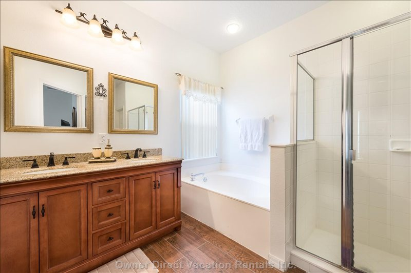 En-Suite Bathroom Includes a Double Shower, Roman Bath and Double Sink Vanity - Recently Renovated