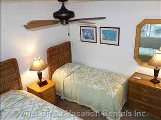 Twin Beds in Second Bedroom Offer Air Conditioning and Fan.