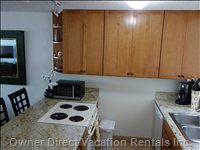 Fully Equipped Kitchen with New Granite Counter-Tops and Custom Cabinets.