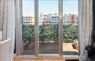 Walk out to the Terrace to Get some Fresh Air Or Enjoy the Views over Sunny Madrid.