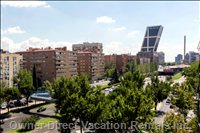 Nice Beautiful Views over Sunny Madrid. Yes, that Building is Leaning like the Pisa Tower, it is Not a Problem with the Camera.