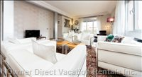 Bright Spacious Living Room with Le Corbusier Sofas and all the Gadgets for a Wonderful Stay.