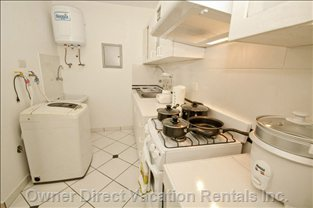 Kitchen / Laundry Area - Well Equipped Kitchen with Gas Oven, Fridge, Freezer, Microwave Oven, Etc. and Washing Machine for your Convenience.