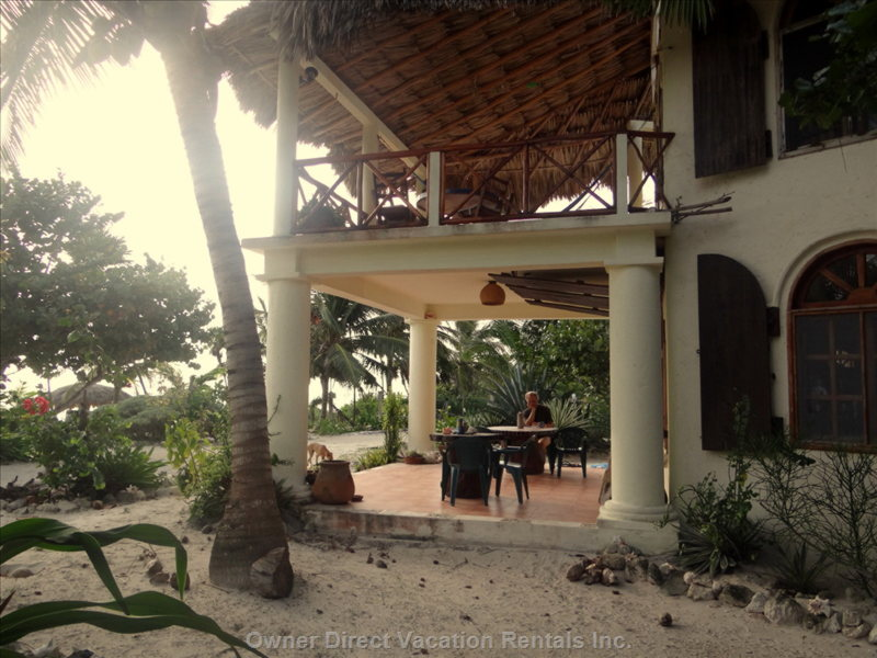 Sea-Side Ground Level Terracce. Fully Tiled and with 2 Tables. - Side View of the House with Ground-Level Terrace. we Take most of our Meals on this Terrace. Beautiful Beach and Caribbean Views from Here.
