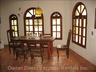 Downstairs Dining Area. - Note the Large Mahogany Windows, which Have Been Custom-build by an Artist-carpenter from Chacchoben and Are a Special Feature of our House.