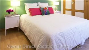 A Large Double Bed with the Fresh Linens in a well-Lighted and Quiet Settings.