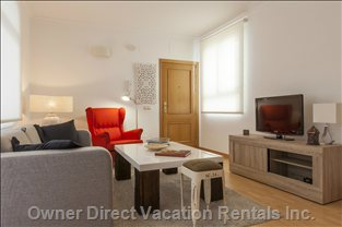A Large Living Room to Lounge, with Double Sofa-Bed Fit for 2 Adults. Tv is Included with Free Wifi.