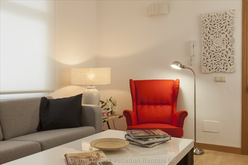 A Corner Spot to Catch up on your Reading with a Reading Light and Comfortable Armchair to Get Comfortable.