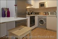 Fully Equipped Kitchen, a Fridge, Oven, Microwave, 4 Top Stove, Kettle, Cappuccino Machine, Toaster and Washer
