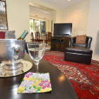 Feel at Home with Quality Furnishings, Oriental Rug, High Def Tv with Premium Cable Package