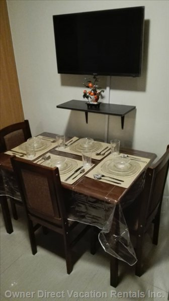 "Dining Set with 32"" Tv and Free Sky 8mbps Internet and Cable."