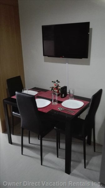 "Dining Table and 32"" Flatscreen Tv with Free 3mbps Internet and Cable."