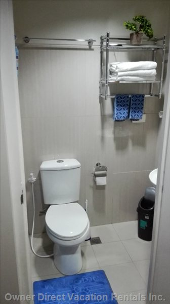 Bathroom with Bidet and Shelves.