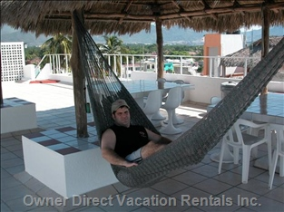 Relax on our Rooftop Palapa.