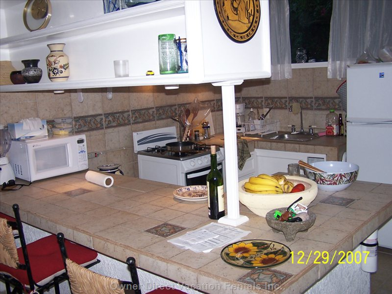 Very Well Equipped Kitchen with Eating Counter.