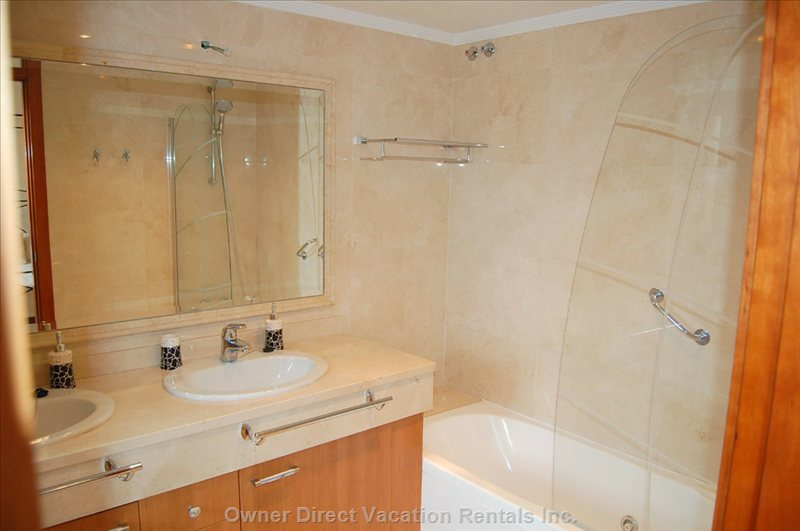 Ensuite Bathroom with 2 Sinks, Whirlpool Tub, Shower, Toilet and Large Built-in Closets.