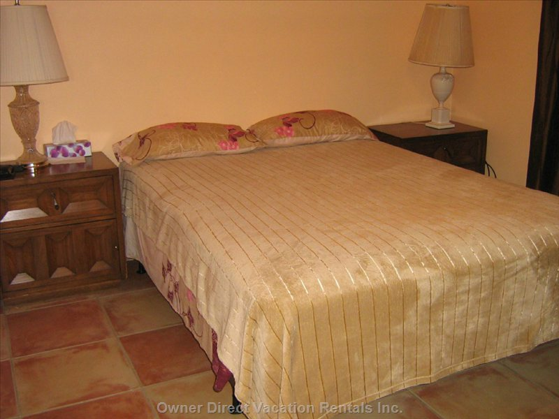 Bedroom 1  with Queen Size Mattress, Dresser with Mirror, 2 Night Tables, 2 Table Lamps, Alarm Clock, Ceiling Fan, Closet.