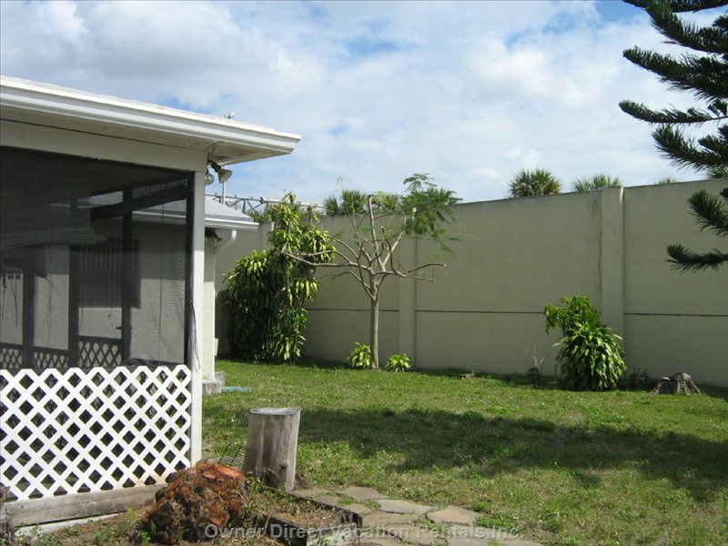 Backyard  with View of Florida Turnpike Wall.