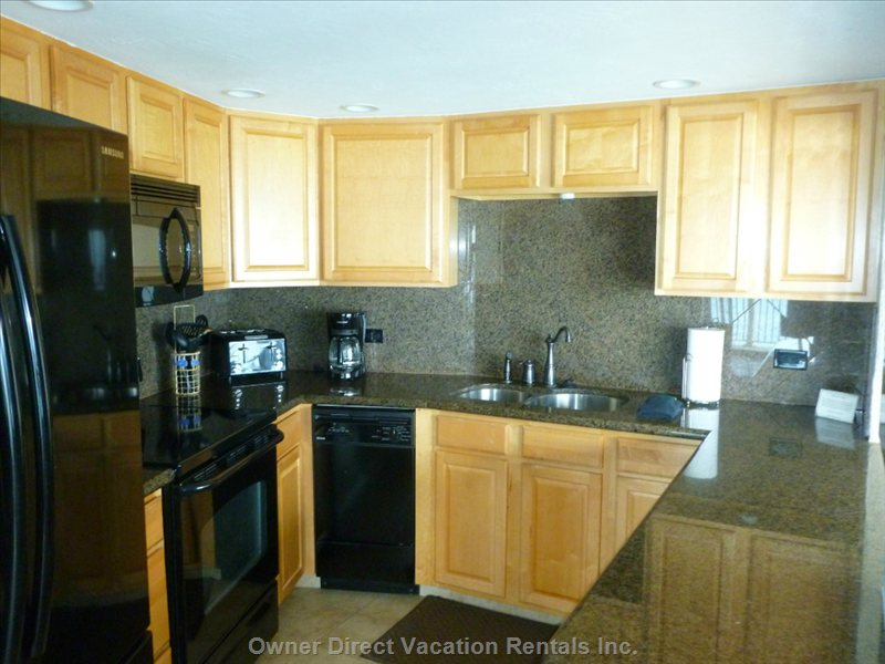Fully Equipped Granite Kitchen: Oversized Fridge with Ice Maker, Oven, Stove Top, Microwave, and Dishwasher!