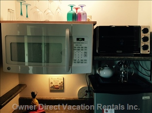 Kitchenette with Microwave, Convection Toaster Oven, Mid Sized Refrigerator, Blender, Coffee Maker and more
