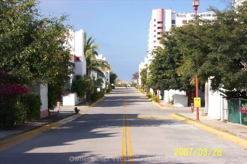 Neighbourhood Street - View of the Street within the Gated Community Leading to our Ocean Front Condominium Building