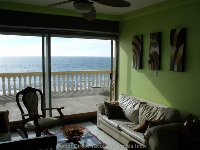 Great Room Looking out onto the Large Waterfront Deck