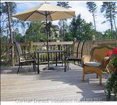We Offer a Large 16 X 24 Ft. Deck with Patio Table and Chairs for 8. There is Also a Webber Bbq.