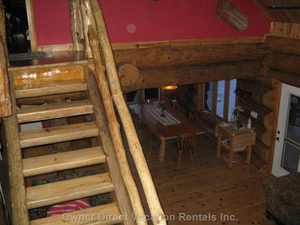 Hand Made Log Straicase to Loft and Master-Bedroom